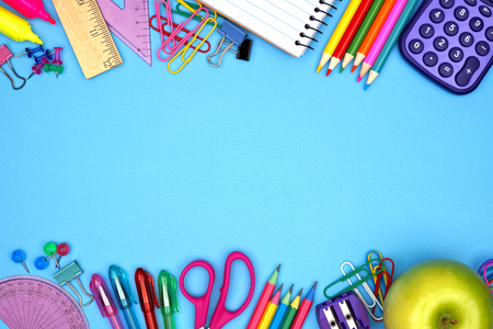 School supplies double border against a blue paper background Stock Photo