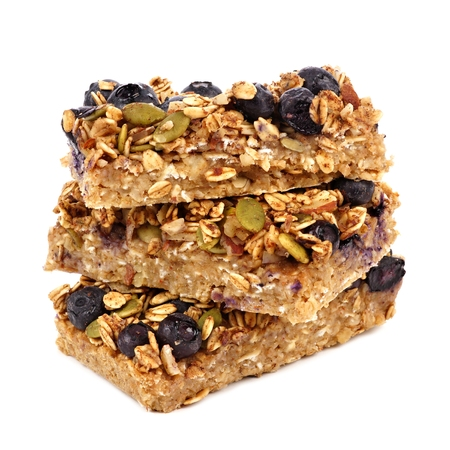 Stack of superfood breakfast bars isolated on a white background Foto de archivo