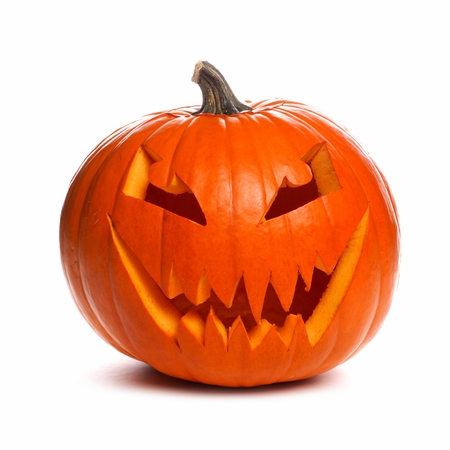Spooky Halloween Jack o Lantern isolated on a white background Stock Photo