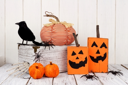 Rustic shabby chic Halloween decor against a white wood background 스톡 콘텐츠