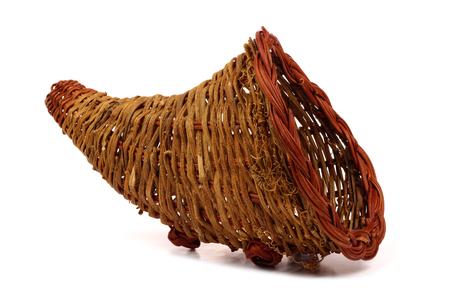 Empty Thanksgiving cornucopia basket isolated on a white background