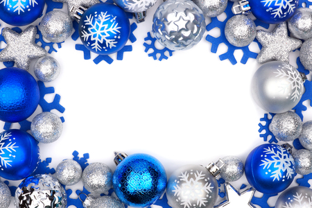 Christmas frame of blue and silver ornaments isolated on a white background Stock Photo