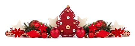 Christmas border with red cloth tree, baubles and branches isolated on a white background