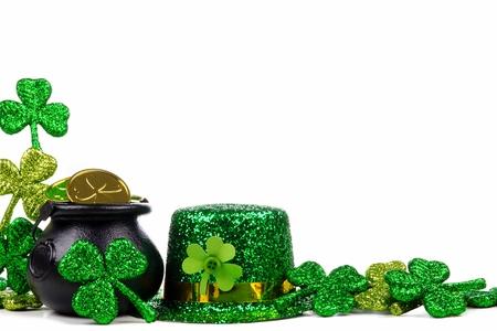 St Patricks Day Pot of Gold, shamrocks and leprechaun hat. Corner border over a white background.