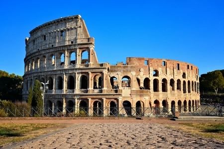 Rome, Italy, the Coliseum. View from Forum with ancient stone road. 新聞圖片