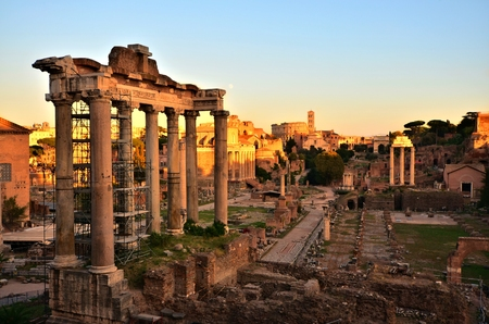 Rome, Italy at sunset. Overlooking the ancient ruins of the Roman Forum towards the Coliseum.