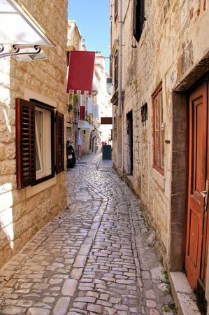 Pretty medieval lane in the old town of Trogir, Croatia