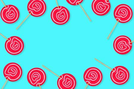 Frame of vibrant pink lollipops against a pastel blue background. Copy space.