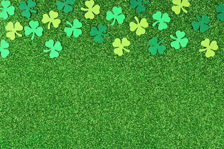 St Patricks Day top border of shamrocks over a shiny green glitter