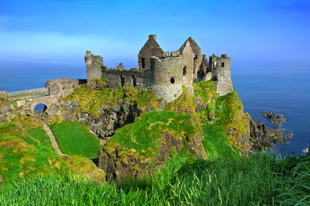 Ruins of the medieval Dunluce Castle overlooking the scenic cliffs of the Causeway Coast, Northern Ireland
