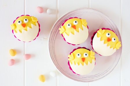 Hatching spring chick cupcakes on a white plate.