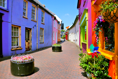 Quaint street lined with vibrant colorful buildings in the Old Town of Kinsale, County Cork, Ireland