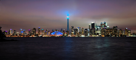 Panoramic view of the Toronto city skyline from the Toronto Islands at night