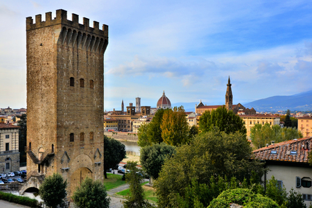 Ancient stone fortress tower with the historic cityscape of Florence