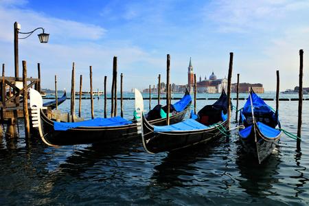 Gondolas at St Marks square with San Giorgio di Maggiore church behind, Venice, Italy