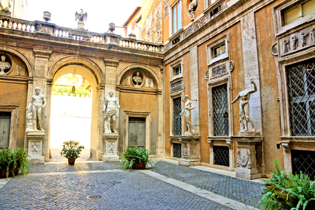 Statue filled courtyard of Mattei Palace in the historic center of Rome, Italy Stock Photo