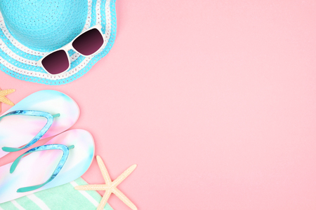 Summer vacation beach accessories side border on a pastel pink background with copy space Stock Photo