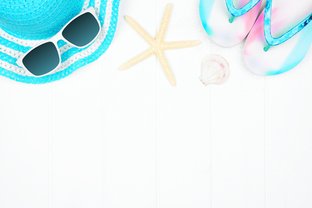 Top border of summer vacation beach accessories on a white wood background with copy space Stock Photo