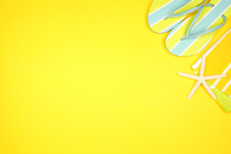 Summer vacation beach accessories corner border on a yellow background with copy space Banco de Imagens
