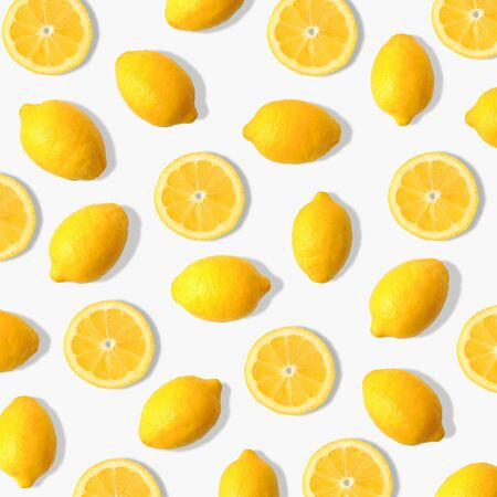 Summer fruit pattern of lemons and lemon slices on a white