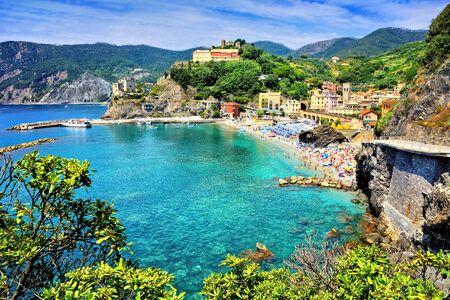 View of the Cinque Terre village of Monterosso over the brilliant blue sea