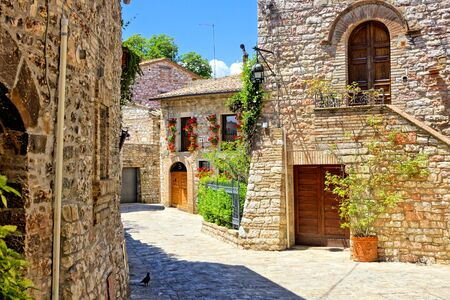 Beautiful stone buildings of the flower filled old town of Assisi, Italy
