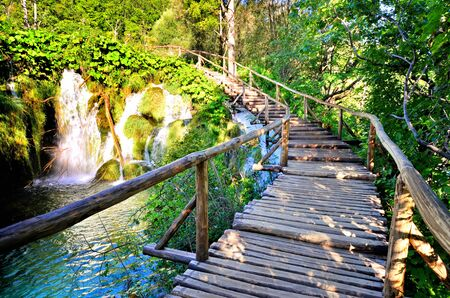 Wooden trail through the scenic waterfalls of Plitvice Lakes National Park, Croatia Banco de Imagens - 128569225