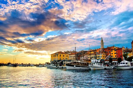 View of the old town and harbor of Rovinj, Croatia with vibrant sunset over the Adriatic sea