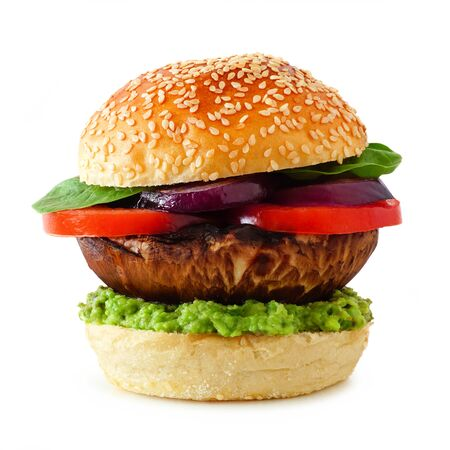 Portobello mushroom meatless burger with avocado, tomato, spinach and onion isolated on a white background 스톡 콘텐츠