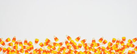 Halloween candy corn border banner on a white background with copy space Stock Photo