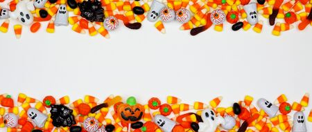 Halloween candy double border banner on a white background with copy space