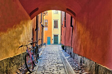 Arched cobblestone street in Gamla Stan, the Old Town of Stockholm, Sweden