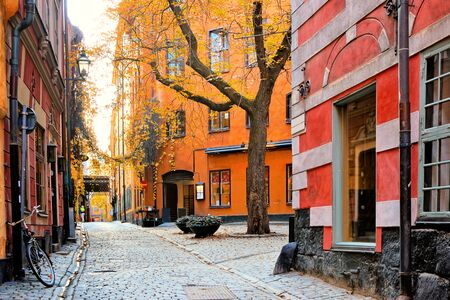 Colorful leafy corner of Gamla Stan, the Old Town of Stockholm, Sweden during autumn Stok Fotoğraf