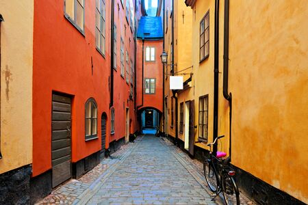 Stockholm street in the Old Town, Gamla Stan with archway and bicycle, Sweden