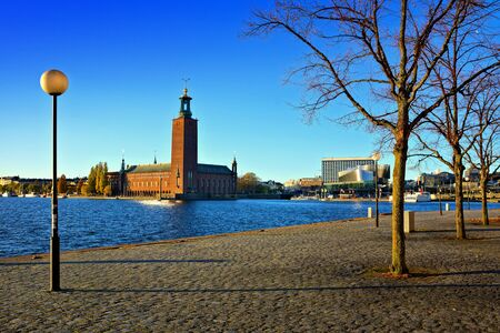 Stockholm, Sweden, view of City Hall from Evert Taubes Terrass, under late day autumn light