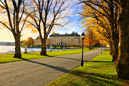 View of Drottningholm Palace through vibrant autumn trees, Stockholm, Sweden