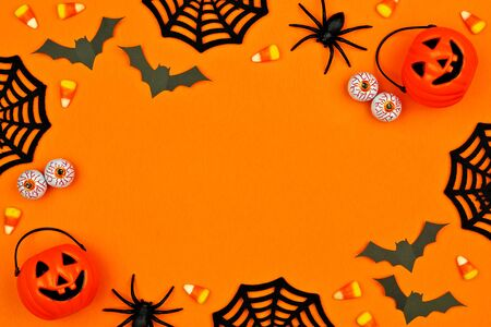 Halloween decor frame over an orange background with copy space Imagens