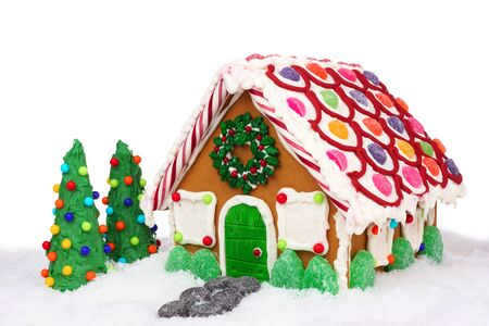 Christmas gingerbread house in snow isolated on a white background