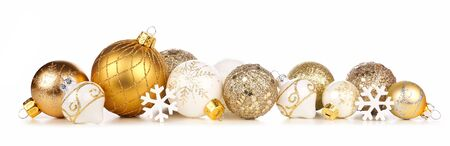 Christmas border of gold and white ornaments, side view isolated on white