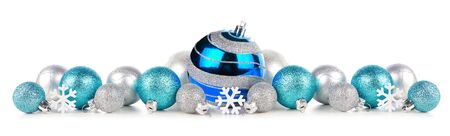 Christmas border of blue and silver ornaments, side view isolated on white