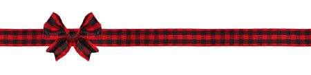 Red and black buffalo plaid Christmas gift bow and ribbon long border isolated on white