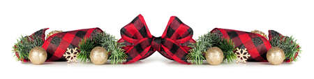 Christmas border of gold ornaments, branches and red and white checked buffalo plaid ribbon isolated on a white background Stock Photo