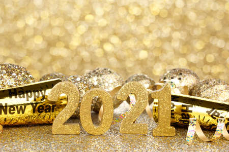 New Years Eve 2021 golden numbers and decorations with twinkling light background Archivio Fotografico