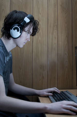 unreachable: Teenager playing online games Stock Photo