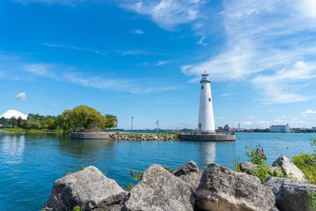 Detroit, Mi - September 7,2019:  Harbor shot of Milliken State Park lighthouse on the detroit river Редакционное