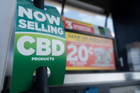 Closeup of CBD promotional product sign at a gas station announcing the selling of oils and other products. Banco de Imagens