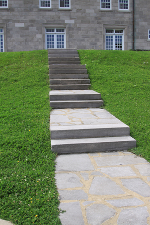Steps and grass to the building Фото со стока