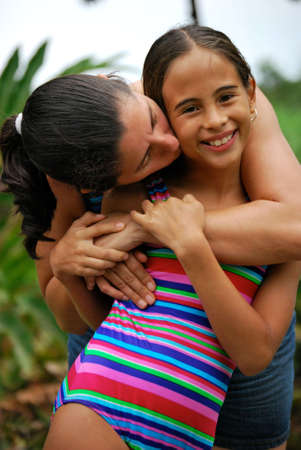 Beautiful little girl hugging her mother