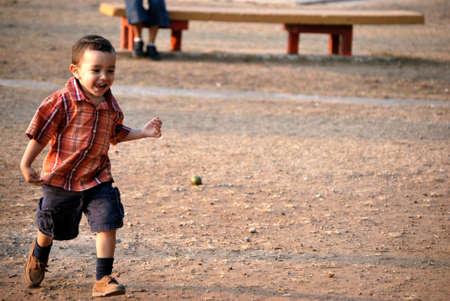 eye ball: Little boy running Stock Photo