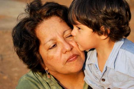 three generations of women: Hispanic Mother and Son